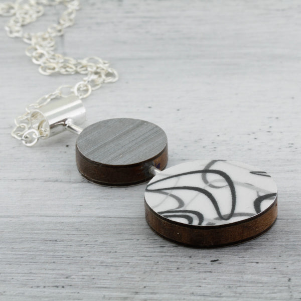 Contemporary art jewelry with laminate on wood boomerang pattern