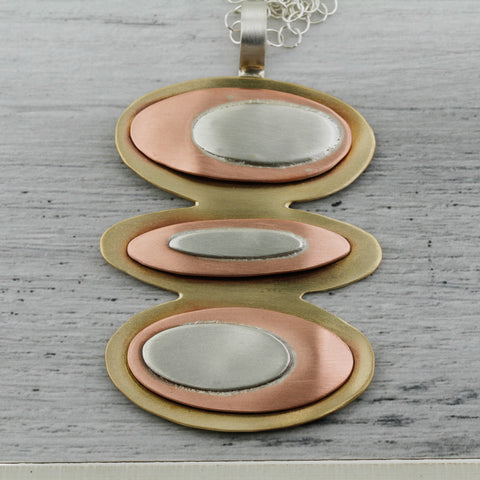 Triple layer of copper, brass, sterling silver space age ovals design mid century modern.