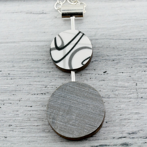 Modernist reversible boomerang pattern laminate on wood necklace