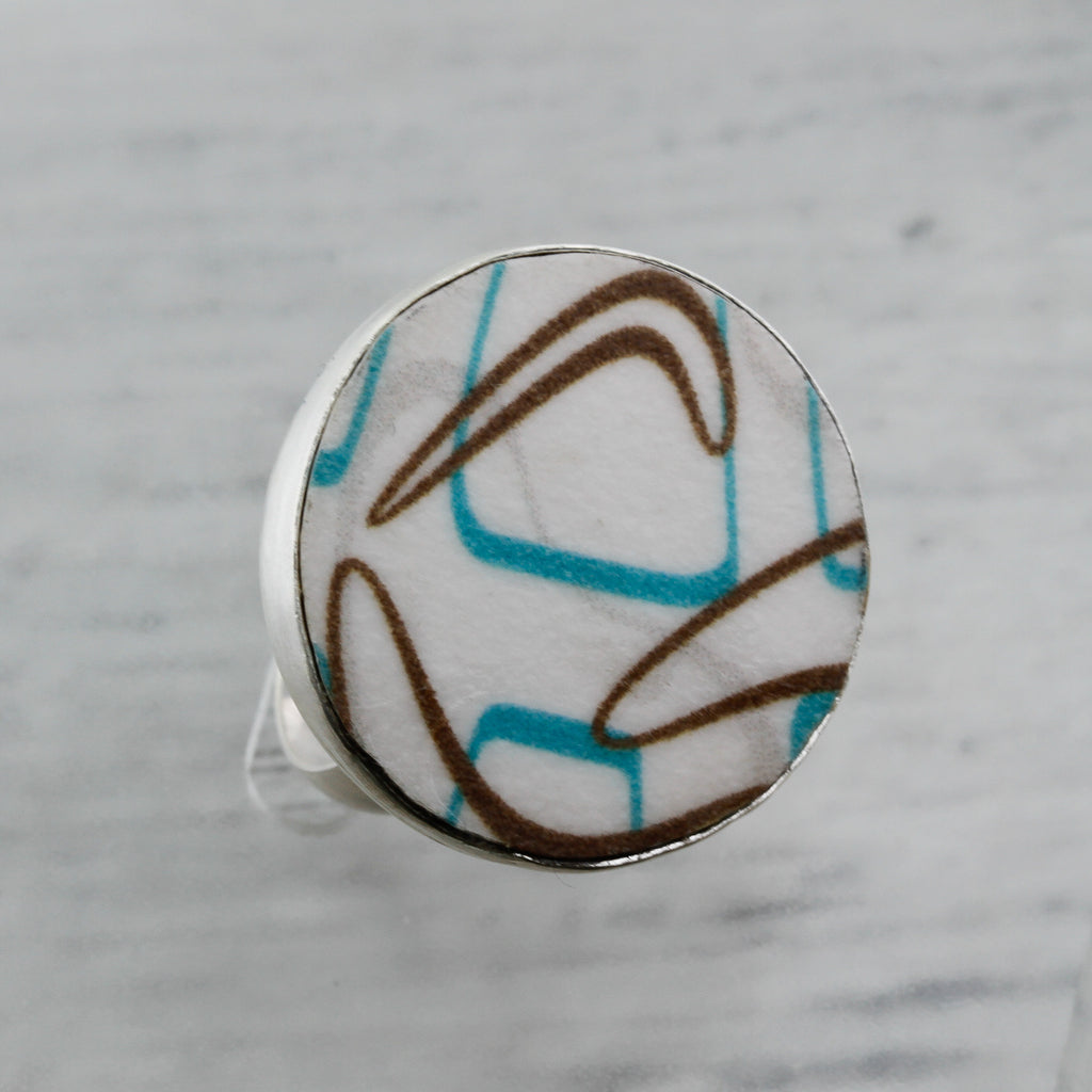 Close up of turquoise and brown boomerang laminate ring sterling silver