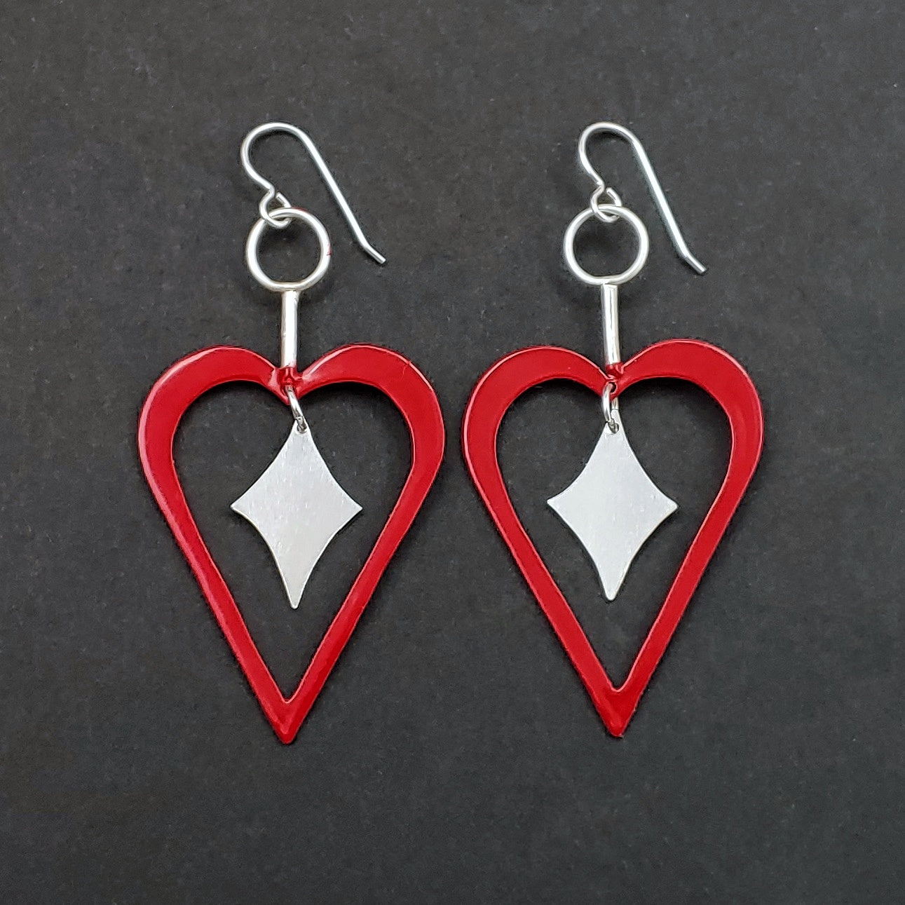 Red heart shaped earrings with sterling silver retro diamonds in the middle