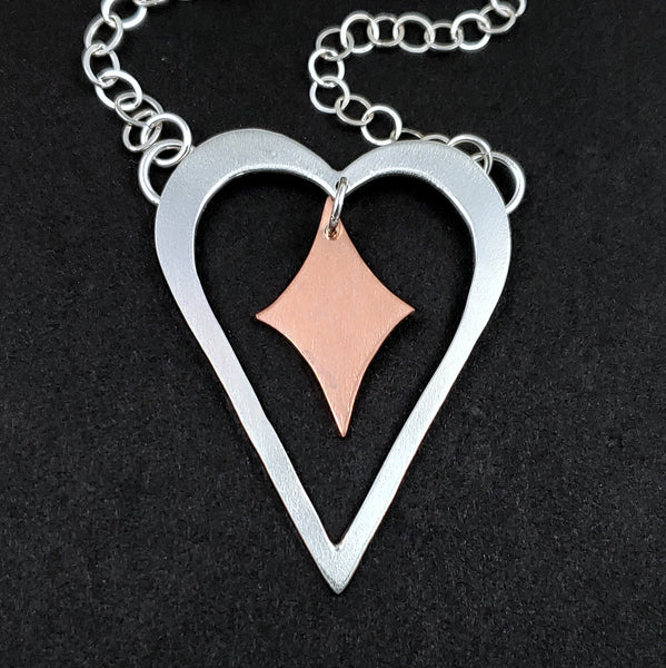Sterling silver heart shaped necklace with copper retro diamond in the middle