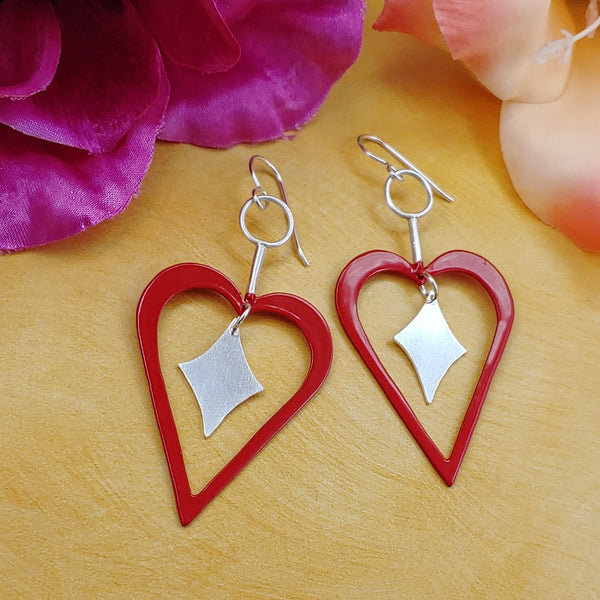 Heart shaped powdercoated red earrings with sterling silver retro diamond dangles in the center