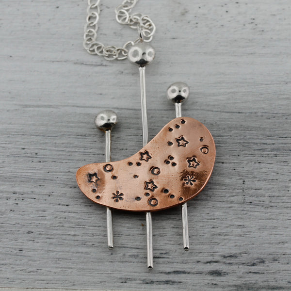 Modernist kidney shaped necklace in mixed metals