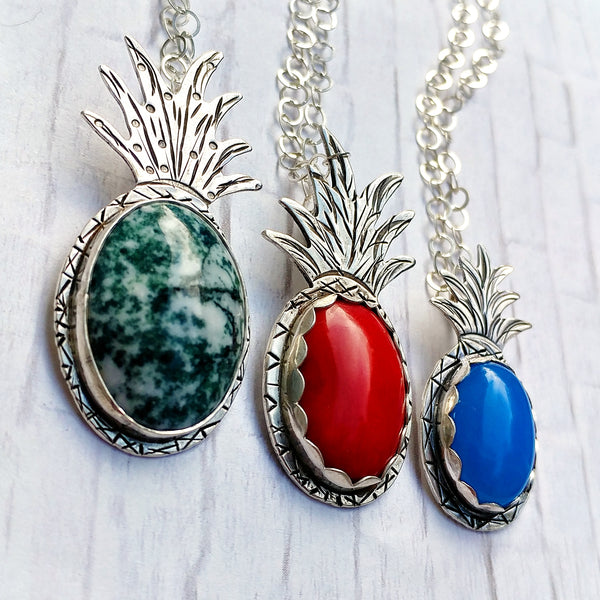 Trio of various gemstones set into a handmade sterling silver pineapple necklace