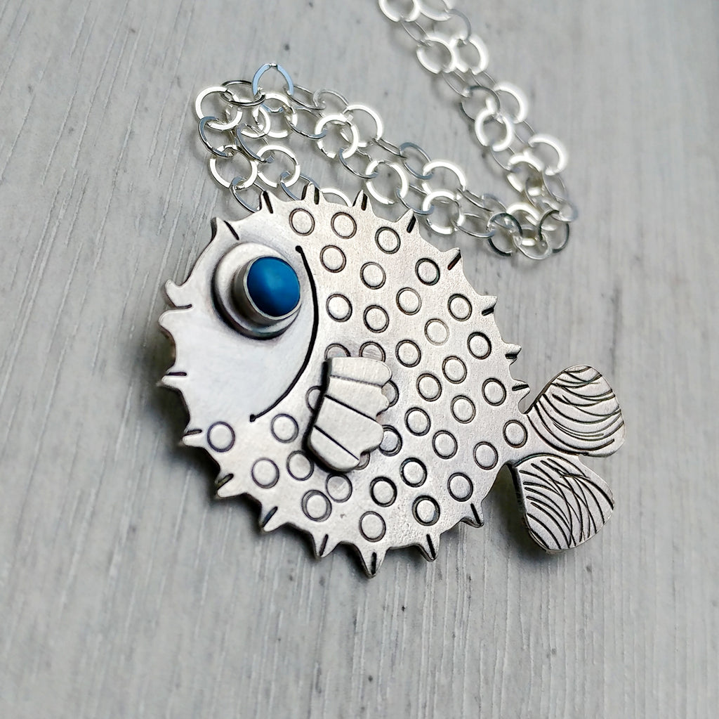 Sterling silver puffer fish necklace.