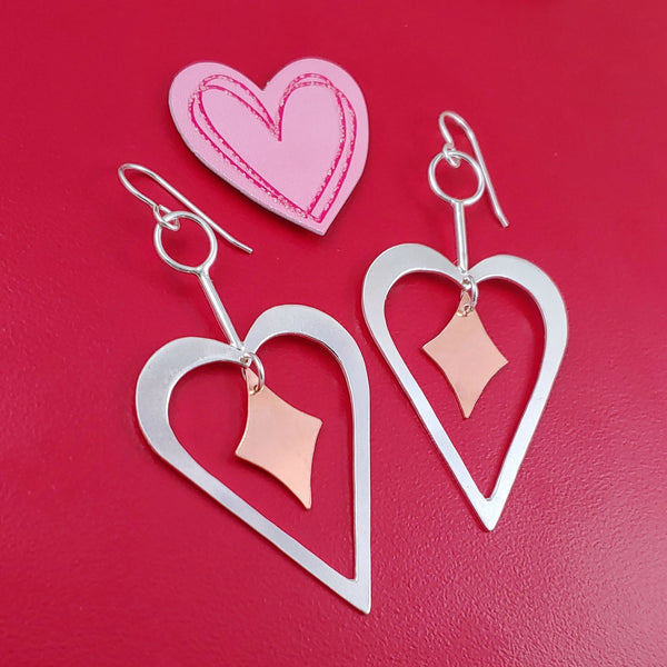 Handmade Sterling silver heart shaped earrings with copper retro diamonds dangling from the center