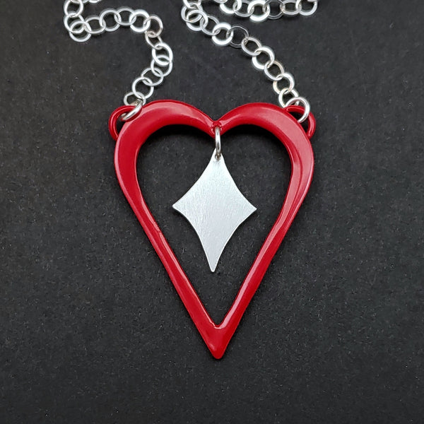 Red powdercoated heart necklace with silver heart