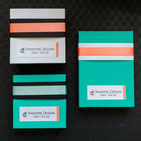 Teal and coral jewelry boxes and labels