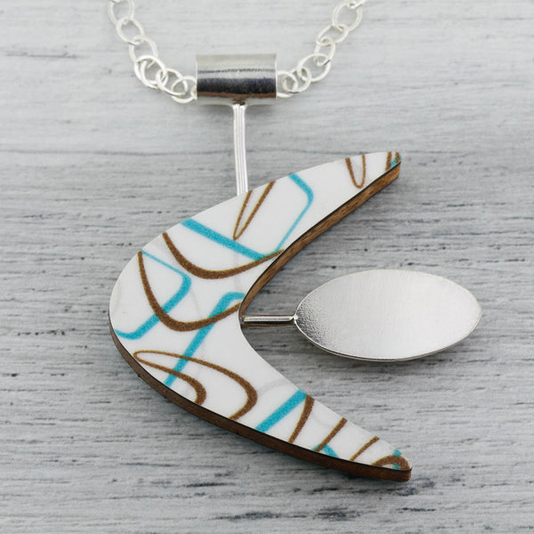 Boomerang laminate necklace in turquoise and white