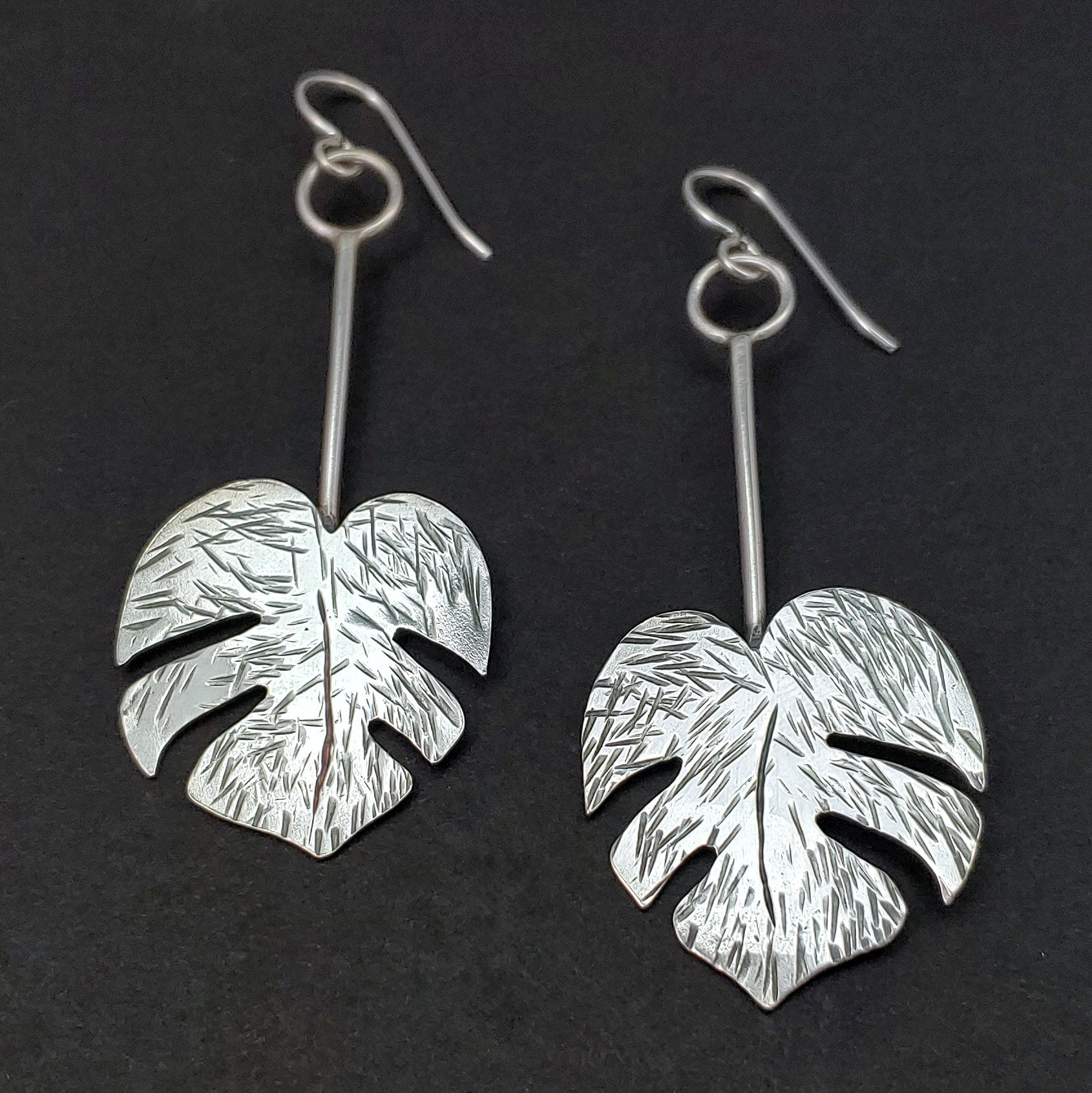 handmade sterling silver monstera leaf earrings tiki