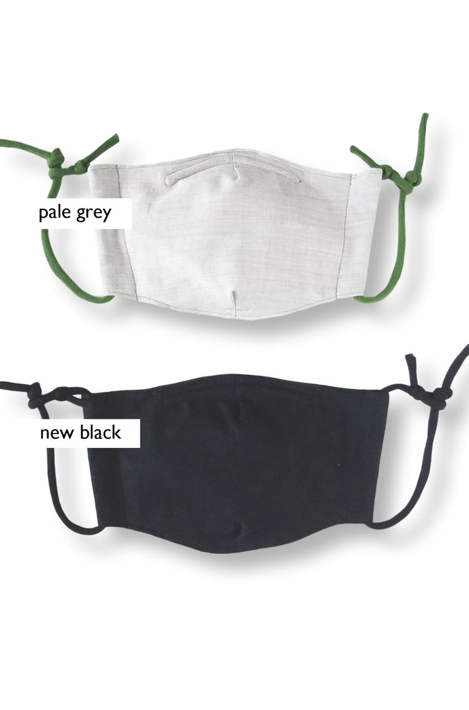 pale grey and black masks