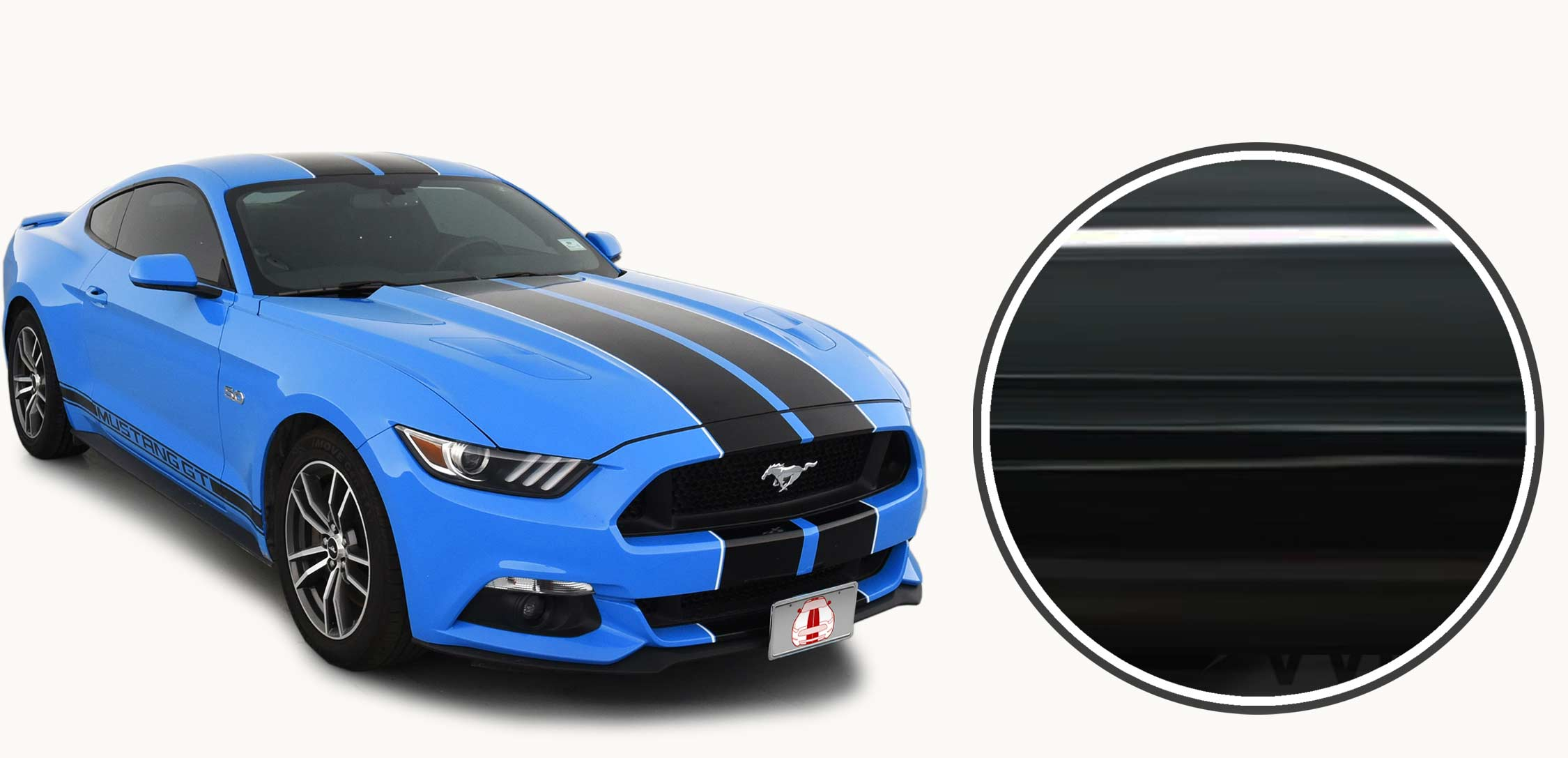 Glossy black racing stripes on a blue ford mustang with white pinstriping