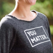 Matter Apparel Women's You Matter graphic print off-the-shoulder black eco-fleece long sleeve sweatshirt