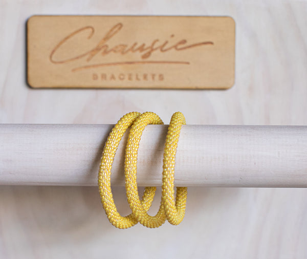 Yellow Lined Crystal Roll - On Bracelet
