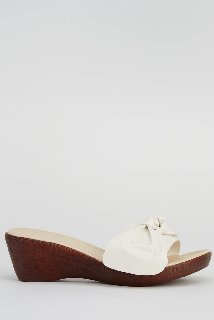 63a52079961e Truffle Collection Bow Front Wedge Sandals – DotiDo