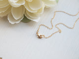 Gold initial coin necklace