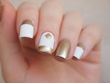 white and gold nails with square gold nail art stud