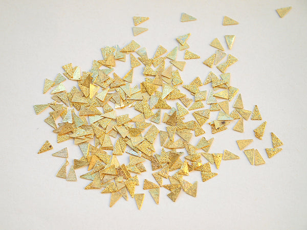 textured nail art studs, gold nail art triangles