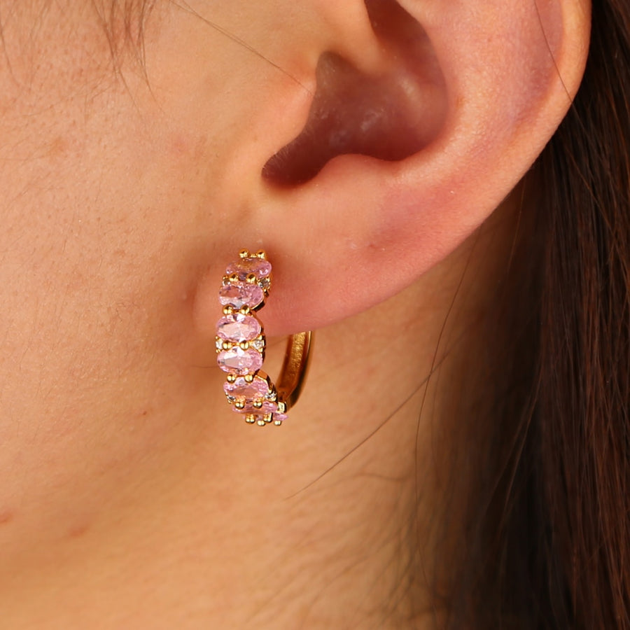 Gold color middle sized hoop oval pink cubic zirconia Anthroplogie