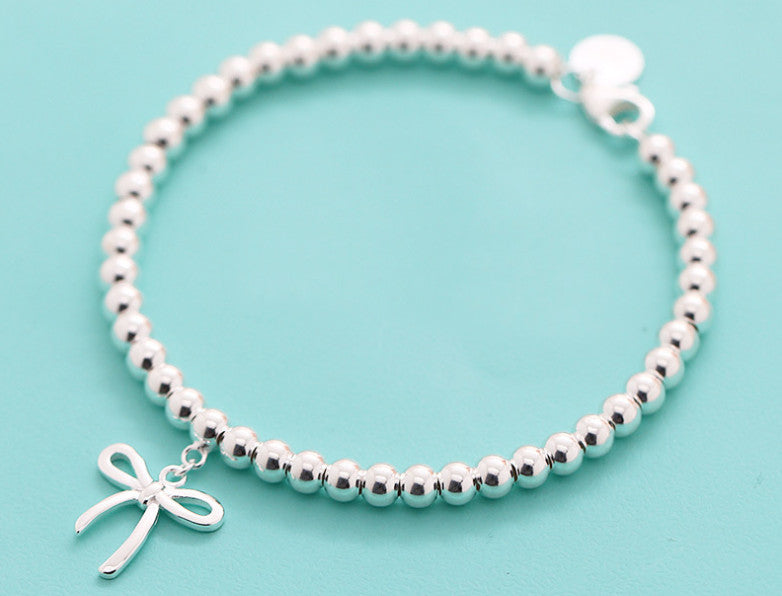 Bracelet with a Bow Charm in Solid Sterling Silver
