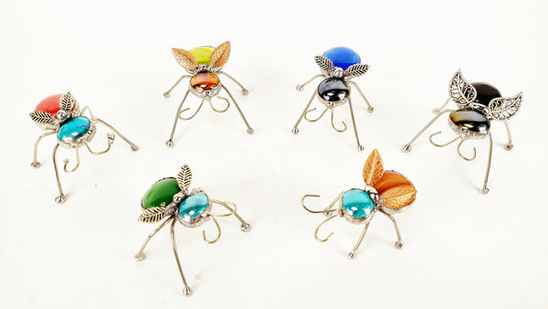 Multi colored winged bugs