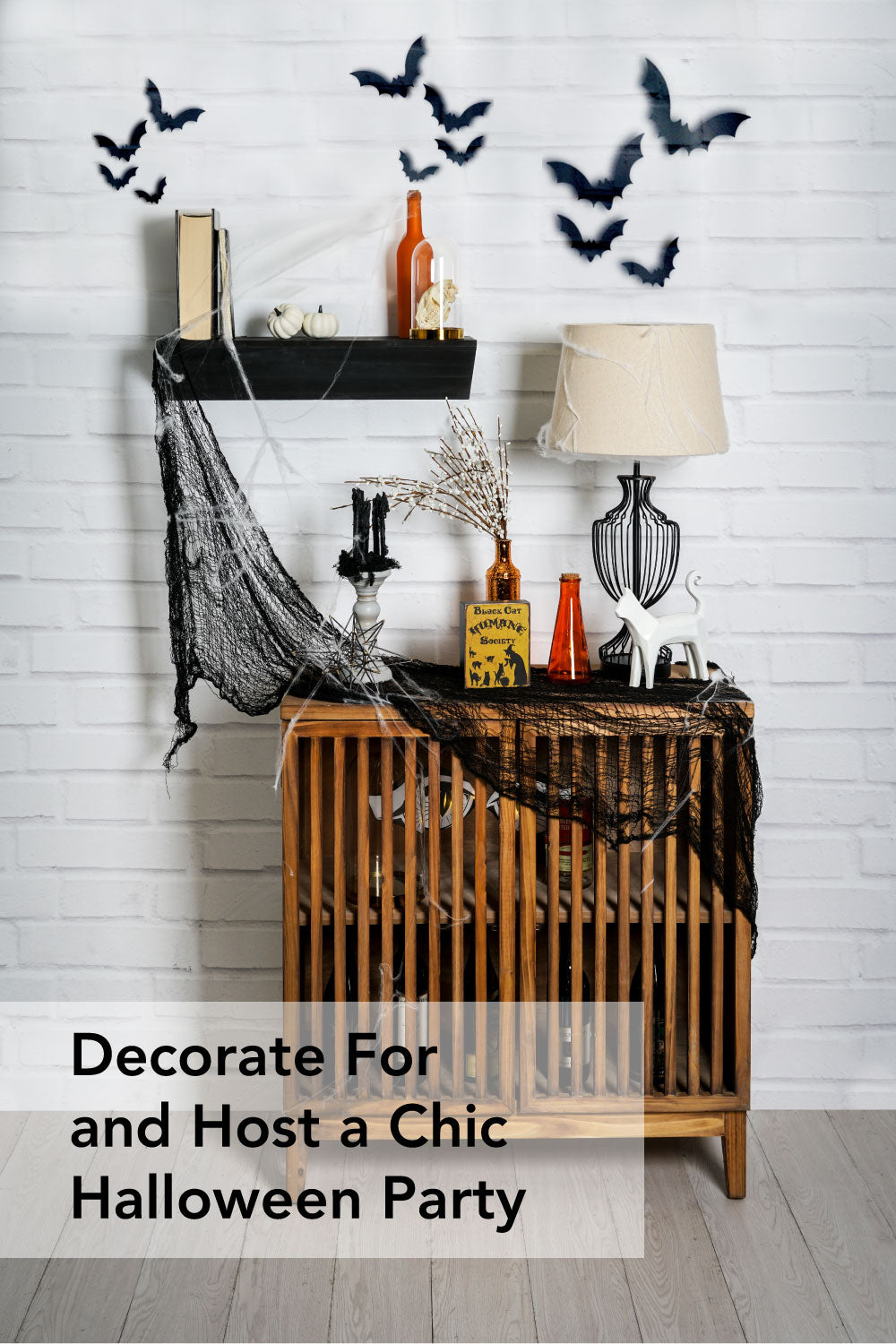 decorate for and host a chic halloween party graphic for pinterest. image of chic Halloween decorations on wood cabinet and black shelf