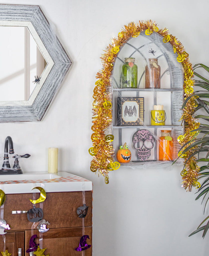 Bathroom with Arch Shelves in Halloween Decor