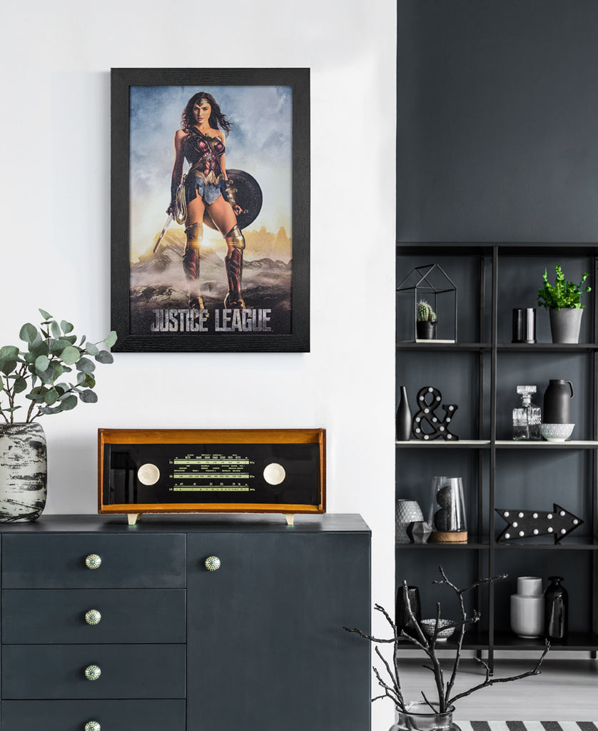Framed Wonder Woman Print on Wall above Radio