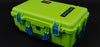 Lime Green Pelican 1510 Case with Blue Handles and Latches on Black Background