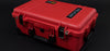 Red Pelican 1510 Case with Black Handles and Latches on Black Background