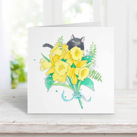 black cat with daffodils greeting card