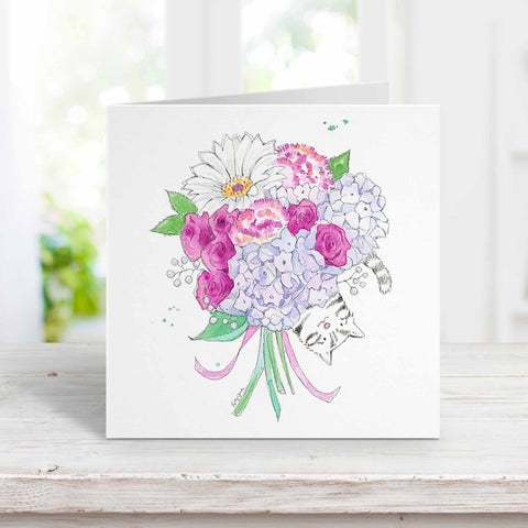 Gray striped cat with bouquet greeting card