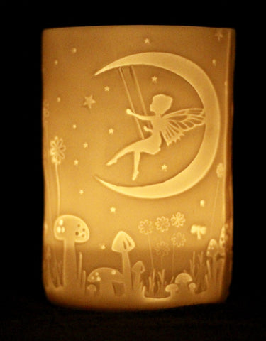trapped fairies on a porcelain tealight holder by stefstorey £15