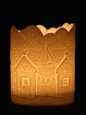 Porcelain Tealight holder with seaside scenery of sailing and beach huts.