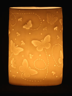 butterflies attracted to the light of the candles porcelain tealight holder handmade by stefstorey