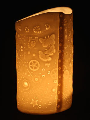 imprinted porclain candle holder depicting the story of Earths history.