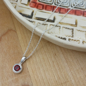 Push Present: Garnet Bezel Necklace