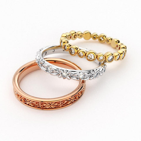 Rose gold, white gold, and yellow gold eternity bands
