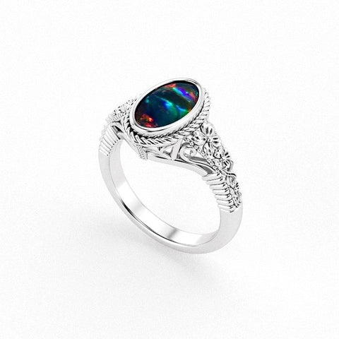 Christine Alaniz Designs custom oval opal ring with vintage floral engraving