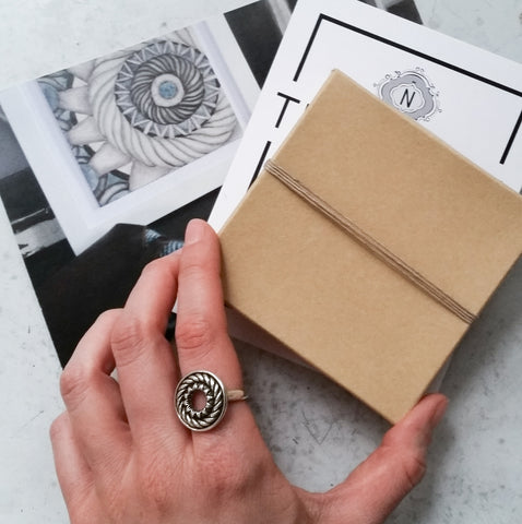 Navona Handmade kraft paper packaging and a sterling silver Portal Ring