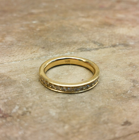 Christine Alaniz Designs custom yellow gold and diamond eternity wedding band, with 14k stamp inside