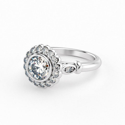 Christine Alaniz Designs custom engagement ring with a round, bezel-set center diamond, surrounded by a scalloped halo