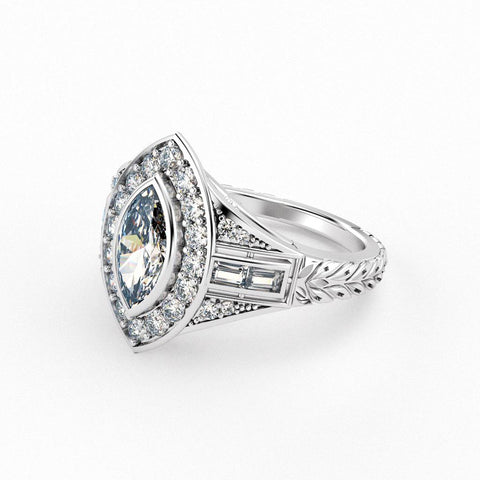 Christine Alaniz Designs antique marquise diamond engagement ring with a halo, baguettes and round diamonds down the shank, and leaf engraving