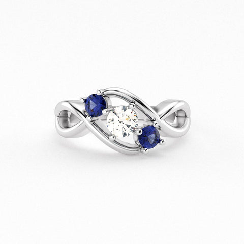 Christine Alaniz Designs 3 stone sapphire and diamond bypass ring