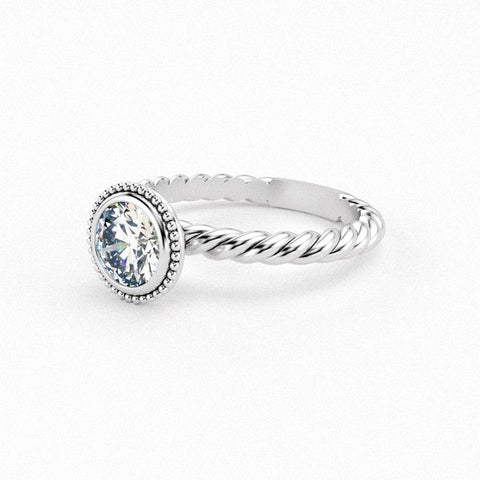 Christine Alaniz Designs round bezel engagement ring with a beaded halo and twist shank