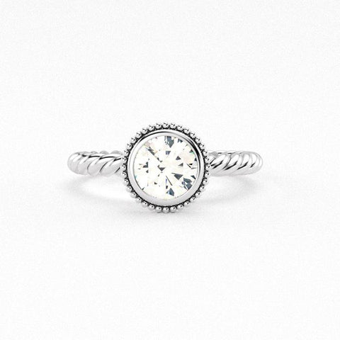 Christine Alaniz Designs round bezel beaded halo engagement ring with a twist shank