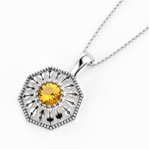 Christine Alaniz Designs Protea Pendant in sterling silver with a round, faceted citrine gemstone in the center