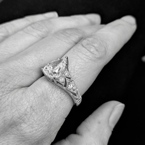 Christine Alaniz Designs - Antique-inspired pear diamond engagement ring with piercings and pavé