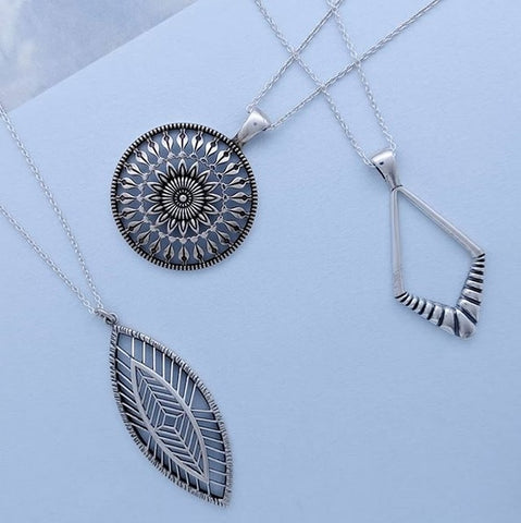 Christine Alaniz Designs - Magnolia Leaf, Protea Amulet, and Darkling Diamond Necklaces in sterling silver
